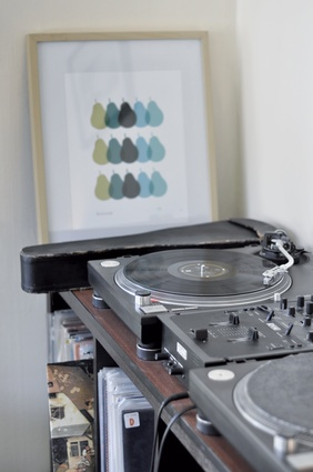 A vintage record player provides the background tunes for cooking nights.