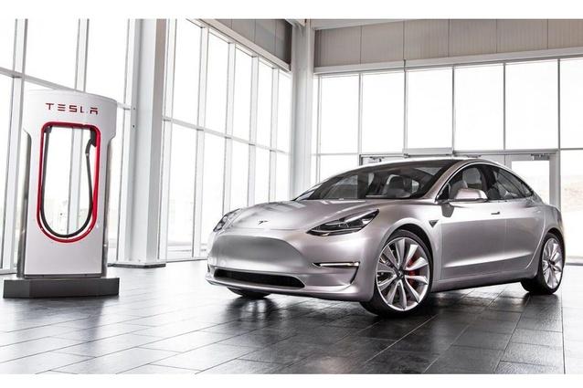 Tesla Model 3 and charging station.
