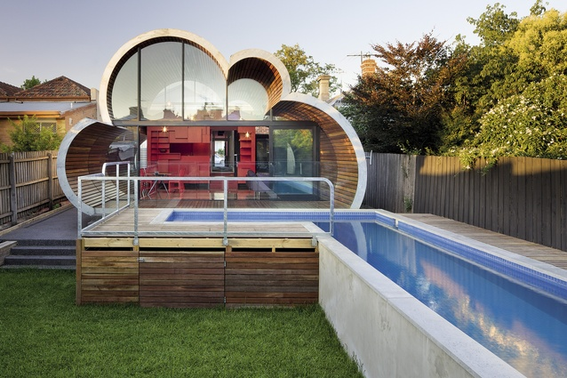 This rear extension takes the whimsical form of a timber-lined cloud.