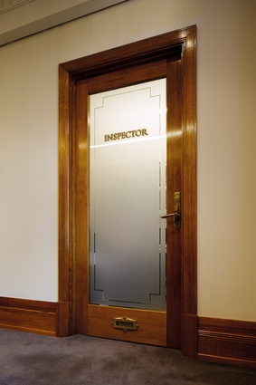 Level 11 features doors with copper and gold leaf signage.