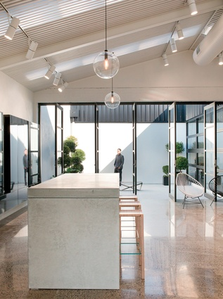 A Retail finalist for the 2014 Interior Awards, Gutiérrez and his team turned a mechanic's workshop in Auckland Central into a showroom / HQ for boutique gift store and wedding registry Mildred & Co.