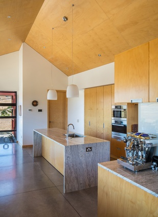 Nohora House. The plywood-clad kitchen.