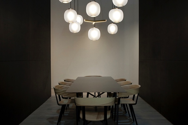 Resident's stand at Euroluce featuring Bloom pendants, Tri pendant, Odin chairs and Scholar table.
