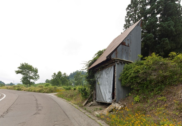 A roadside hut in Matsunoyama, used for communal storage.