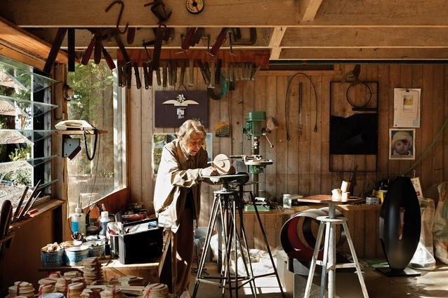 Inge King in the underfloor studio, where the  exposed structure serves as racks for tools or places to hang works in progress.