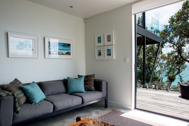 Marine colours in the living room reflect the casual, seaside feel of the bach.