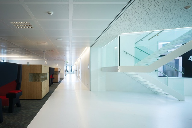 Leyster's <em>Pekelharing</em> is referenced in the building's quiet, neutral workspaces and the way they are contrasted with the lively meeting spaces.