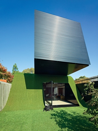 A hill clad in artificial turf topped with a cantilevered box forms the 2011 Hill House.