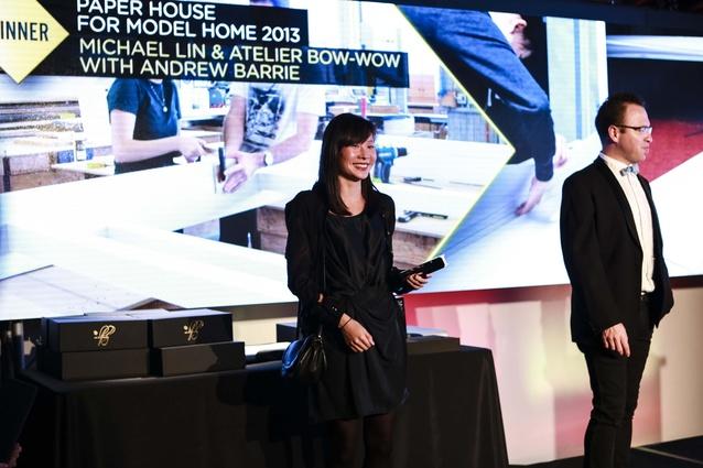 Melanie Pau receiving Installation Award for Paper House Model Home 2013.