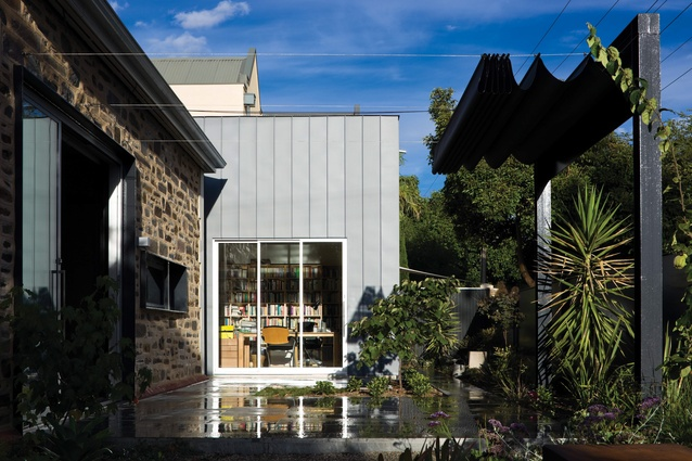 The materiality of the rear addition to the Norwood Residence (Adelaide 2012) is in stark contrast to the existing home's stone walls.