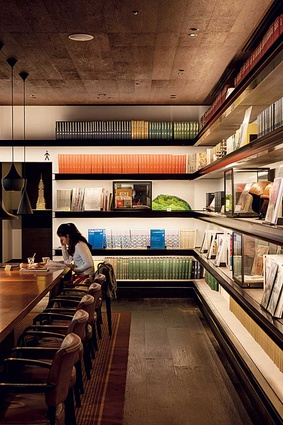A second floor cafe doubles as a library.
