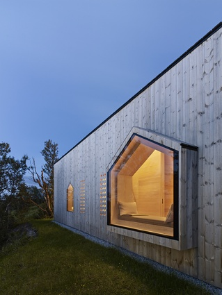 A south-facing perforated window filters light while ensuring that the gable end views are the main focus.