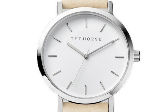 The steel-and-nude version has a white face and a vegetable-tanned leather band.
