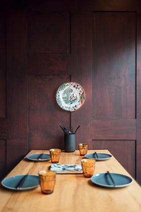 The original timber-panelled walls were retained and stained walnut, giving the space the sense of an ancient wooden box.