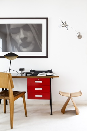 A 1953 Jean Prouvé Bureau Compas desk with a Trépied lamp by Serge Mouille, and putrelle by Enzo Mari.