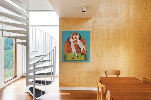 During the day, Ampelite cladding near the stairwell floods the interior with natural light. Artwork: Andrew Sibley, <em>Rod and Sally In Love</em>.