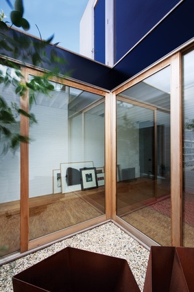 A small courtyard separates the guest wing from the house.