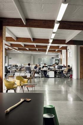 The upstairs open-plan office space is more spartan.