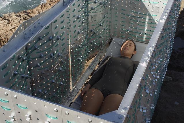 A still from a film depicting <i>Sleep Sarcophagus</i> by Matthew Bird of Studiobird.