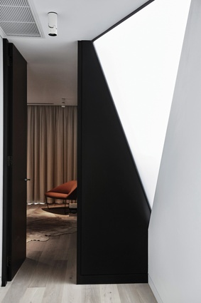 A triangular frosted window on the upper level adds natural light and a touch of drama.