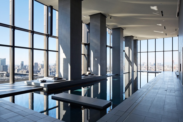 Even while swimming, guests can enjoy views of the Imperial Palace and Mount Fuji. Positioned on the southern side of the thirty-third floor, the pool is lined in black granite to match the stone floor paving used throughout the hotel.