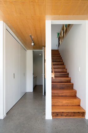 A recycled matai staircase lines the back of the kitchen bench.