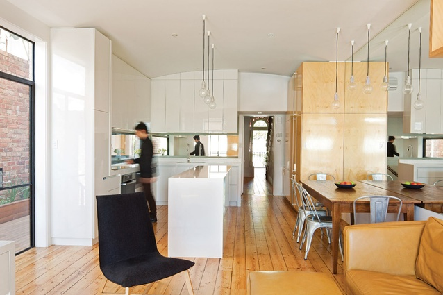 A marriage of opposites: the kitchen's white gloss and hoop pine joinery.
