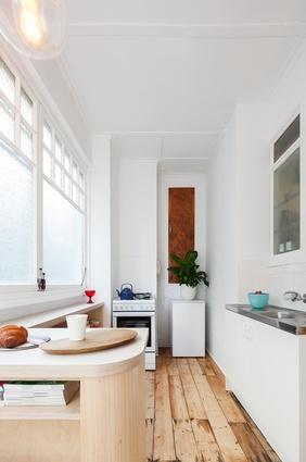 The studio apartment now has a distinct space for cooking.