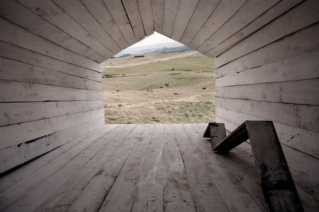 Inside the structure is a bench from which to gaze out at the countryside.