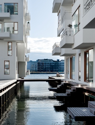 Havneholmen mixed-use development in Copenhagen contains 236 apartments and consists of two U-shaped blocks with with inner courtyards.