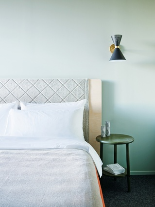 The guest rooms' wall colours dictate the colour palette of loose furniture, upholstery and linen.
