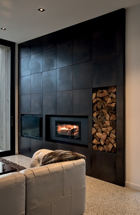 The dark living room wall balances visually with the views outside.