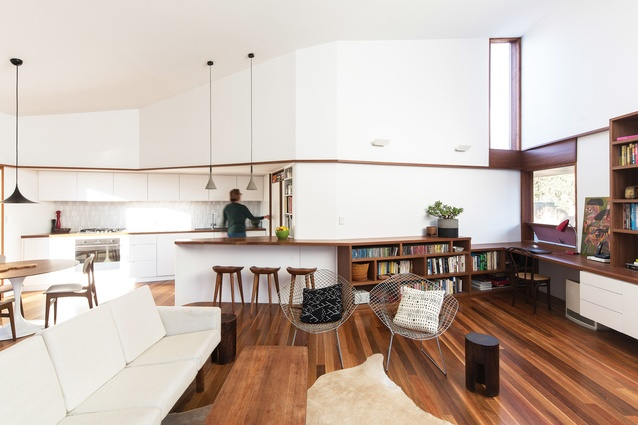 The living area is one large space, broken down using joinery and ceiling heights.
