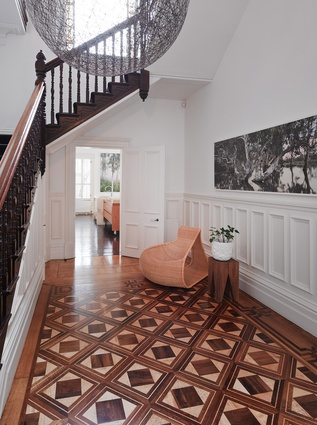 An elegant Victorian stair leads up to the bedrooms. Artwork: Nici Cumpston, Gallerysmith, North Melbourne.