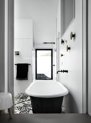 The claw-foot bath and grooved wall panelling invite nostalgia.