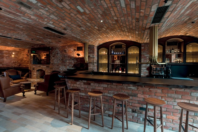 The Alibi bar has a vaulted brick ceiling and a speakeasy feel.