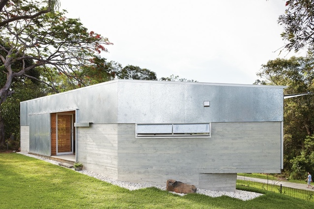 Low-maintenance skin of concrete and galvanized steel.