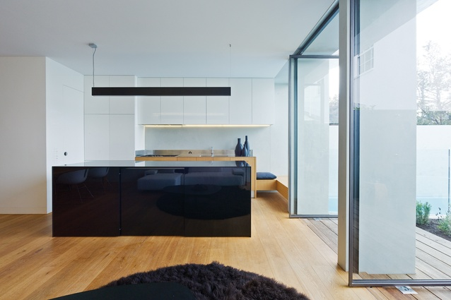 The Paddington House 2 kitchen is welcoming and beautifully detailed, with a window seat adjacent to the pool.
