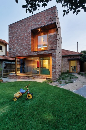 "A ""contemporary vision"" has been placed at the back of a circa 1940, austerity-style home."