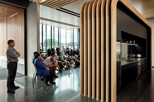 The events and cafeteria spaces are separated by an elegant plywood divider – the individual curved pieces are splice-cut and glued to straight pieces.