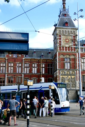Tram at Centraal Station, Amsterdam: transport hubs are a vital part of an integrated public transport system, reducing citizens' reliance on cars.