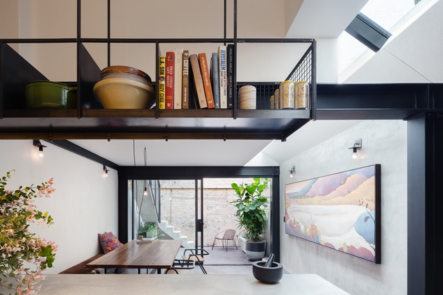 The living area remains bright and cheerful thanks to the large skylights above.