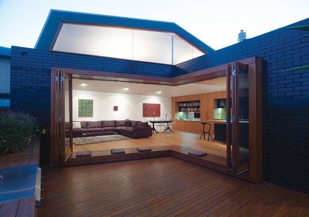 Birchgrove House, Sydney, NSW, 2008: The kitchen and living area wrap around the external courtyard.