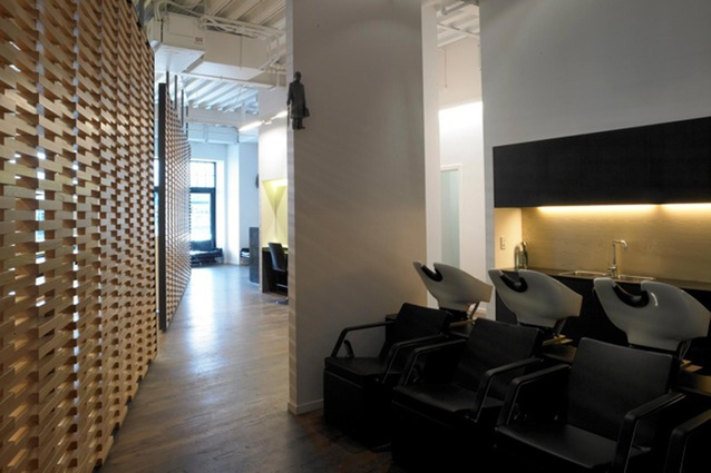 The shampoo area is separated from the styling area by ornate timber wall screens.