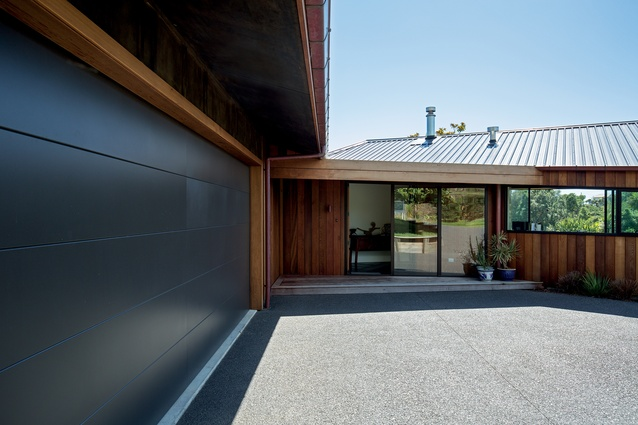 The foyer acts as a linking element between the main house and the guest wing and garage.