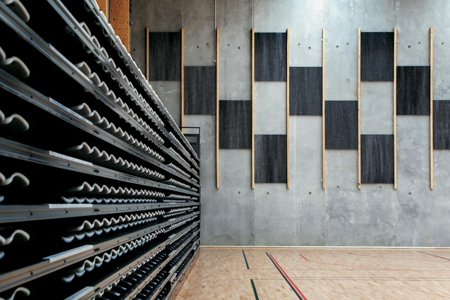 Acoustic panels create a stepped pattern symbolizing climbing for knowledge.