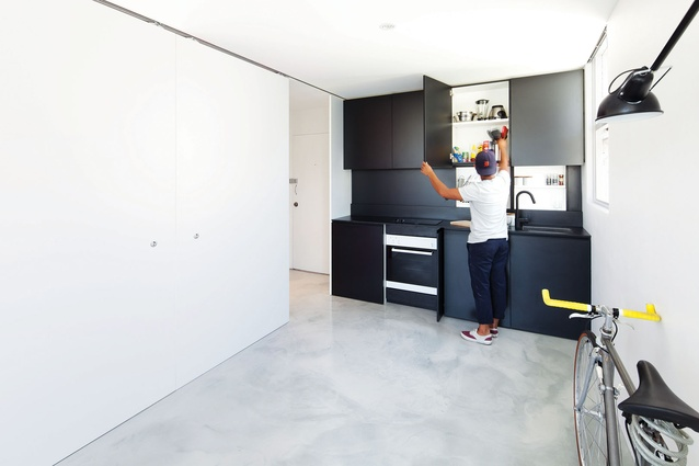 Appliances are concealed behind cabinetry, and all finishes are matching to allow the kitchen to read as a unified whole when the cupboards are closed.