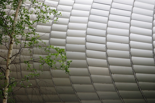 A perforated aluminum screen covers the Pathé Foundation by Renzo Piano Building Workshop to provide privacy and sunshading.