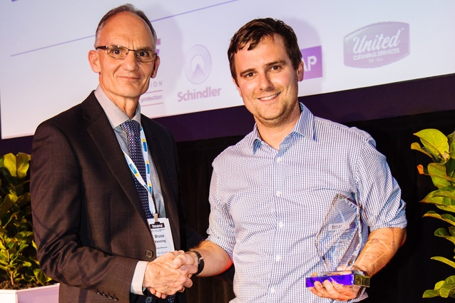 FMANZ chairman Bruce Kenning congratulates Young Achiever of the Year Award winner Gregory Emms.