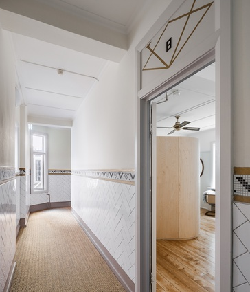The communal corridor leading to the refurbished apartment.
